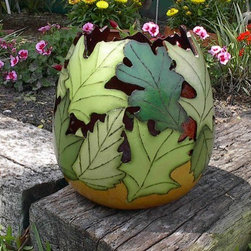 Summer Green Leaves Gourd Bowl or Vase - This gourd bowl has a totally unique feel. The leaves are cut out to make a cool pattern of interlocking leaves. I love how the different shades of green really makes the leaves stand out.