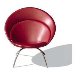 Nanna 2650 Easy Chair - Nanna Ditzel designed the Nanna Easy Chair in 2002 with a curved, flexible back, which adapts to the body. This model features stainless steel legs.