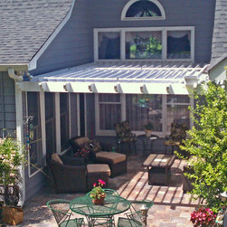 Arcadia Louvered Roofs - Arcadia Louvered Roof - Installed Units - Arcadia Louvered Roof attached on three sides to the house and covers a patio.