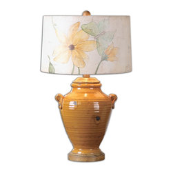 Uttermost - Amarillo Ceramic Table Lamp - Ceramic base finished in a crackled antiqued gold glaze accented with dark rustic bronze details. The slightly tapered round hardback shade is hand painted antiqued ivory with aged yellow daisies and butterfly motif. Due to the nature of fired glazes on ceramic lamps, finishes will vary slightly.