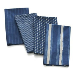"Set of 4 Indigo Block Print Napkins - Created exclusively for Crate and Barrel, these gorgeous textiles are handcrafted by skilled Indian craftsmen using time-honored techniques. Each design is created with a traditional mud-resist method of block printing known as ""dabu."" Fabric is then dyed in large vats of dye derived from the indigo plant. Some of these solutions may be up to 200 years old, as new plant material is continually added so that the tubs are never depleted. Variations to the distinctive blue color are characteristic of the handcrafted process and make each napkin truly one of a kind."