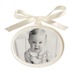 """Exposures - Custom Porcelain Photo Ornament - Overview Create a treasured keepsake for parents or grandparents with this custom porcelain photo ornament. Well transfer your photo directly onto an oval ivory porcelain ornament in your choice of B&W, color or sepia. Personalize the back with your message in gold script (up to 2 lines, 13 characters per line). Ivory satin hanging ribbon included. Photo ornament measures 3 1/2"""" x 4 1/2"""". No returns on personalized items unless the item is damaged or defective"""