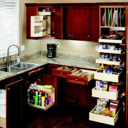 ShelfGenie Kitchen Pull Out Shelves - ShelfGenie of Austin has a solution for every area of the kitchen.  This kitchen features:  pull out trash and recycling bins, pull out shelf with riser beneath the sink, tip out tray in front of the sink, Glide-Around corner unit in the upper cabinet, utility drawer inserts, tray dividers, and pull out pantry shelves.