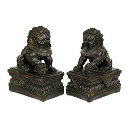 Oriental Unlimted - 2 Pc 9 in. High Foo Dog Statues - Mirrored pairs. Great displayed on a shelf, mantle or as book ends. Large and heavy cast resin reproduction of classic Chinese fu dogs. Beautifully finished with a dark faux antique Bronze patina. 6.5 in. W x 4 in. D x 9 in. H