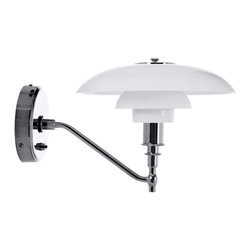 The Herlev Wall Sconce Chrome With White Glass Shade - The Herlev wall lamp features a series of three nested glass shades of decreasing diameter. It can use up to an E26 100W bulb (MAX; not included) within its frosted shade assembly. The lamp is supported by a thin arm that drops slightly to position it at mid-height to the mounting unit. The switch for the lamp is fitted into that unit.