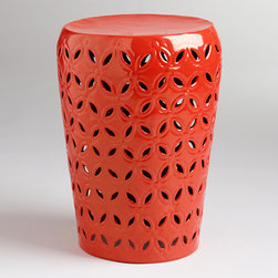 Orange Lili Punched Drum Stool - Ceramic stools are all the rage right now, but I love the fact that this one is made of powder-coated metal for durability, making it a good choice for a patio.
