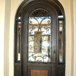 """Mediterranean Iron Doors - 3'6"""" x 8' Marbella round top with wraparound transom. By The Front Door Company."""