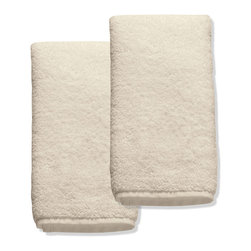 "Frontgate - Set of Two Resort Cotton Fingertip Towels - Long-staple Turkish cotton that is finely combed for a smooth, soft feel. 700 grams per square meter results in superior plushness and absorbency. ""Zero Twist"" process plumps and stabilizes the yarn while revealing more of the cotton fiber. View towel care instructions. Made in Turkey. Softer and longer than towels found at many five-star hotels and spas, our Resort Cotton Towels are lofty, thick, and as luxurious as any in the world. These zero-twist towels are crafted from pure, 100% long-staple Turkish cotton woven to 700 gsm. The end result is luxuriant softness and absorbency that outperforms others. . .  ."