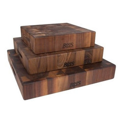 John Boos Walnut Cutting Board with Grips - Perhaps so many people order out or go to the drive-thru because they don't have the John Boos Walnut Cutting Board with Grips. If you could start each meal by prepping on blocks of thick, solid walnut, why would you go anywhere else? Each block is finished with a mixture of paste and beeswax that gives it a food-safe exterior that protects the wood and shows off the natural beauty of the tight-grained lumber. Simple grips on each side make it easy to control and also give you the opportunity to use it as a serving tray as well as a cutting surface. Available in your choice of size.About John Boos ProductsLocated in Effingham, Ill., John Boos has become world-renowned for their high-quality kitchen products. Not only is John Boos proud to be featured by numerous celebrity chefs on Food Network programs and others, but they also keep an eye on their environmental footprint. Protecting the environment is an integral part of John Boos' business practice. They're firmly committed to using sustainable resources, recycling byproducts, and maintaining healthy air quality as they manufacture their products. John Boos has been awarded the Gold Medal for Excellence in Foodservice Equipment by the Chefs of America, a prestigious acknowledgement of their commitment to quality.