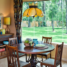 Rustic Dining Room by By Design Interiors, Inc