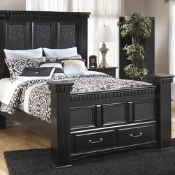 Signature Design by Ashley - Signature Design by Ashley Cavallino Black Storage Poster Bed - The Cavallino poster bed from Ashley Furniture will add a luxurious touch to your bedroom motif. The elegant colossal design is enhanced by shapely mouldings and grand large-scale footboard that offers two spacious storage drawers.