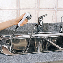 """Renovators Supply - Kitchen Faucets Chrome Kitchen Faucet W/ Telescoping Sprayer - Kitchen Faucet: A perfect addition to the well-equipped kitchen, this chrome European-style faucet is armed with a combination sprayer/spout that has a 4' long hose for plenty of reach.  The touch of a button provides either spray or stream settings.  Ceramic washerless valves; vacuum breaker.  With a 9 1/4"""" projection, it stands 6 3/8"""" high on a 10 3/8"""" long by 2 1/2"""" wide base plate."""