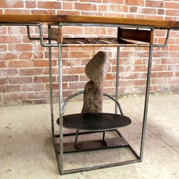 "Abstract Rock Sculpture Desk - What's a desk without a bit of whimsy?!  This perfect small desk is just what the Dr. ordered if you are looking for a desk or end table that's practical and simultaneously decorative.  That's exactly what our welder did when combining multiple natural elements into this one design.  The old pine top is perfectly paired with the copper shelf and raw steel legs and is the just the right size for anyone with a lap top.   The stone sculpture below adds the subtle touch of whimsy that makes this one of a kind.   Size seen:  40""l x 17""w x  28""h."