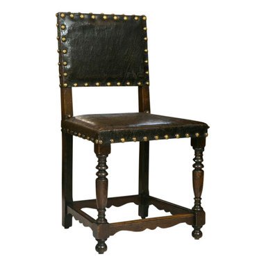Consigned Antique English Leather Dining Chairs, Set of 6 - An incredible set of all original late 18th Century British oak and leather side chairs. The over all condition is excellent and includes well-turned front legs, scrolled side and back stretchers, and oversize brass nail-head ticking.