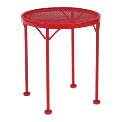 Woodard - Woodard Sculptura Round Wrought Iron End Table - 4G0039 - Shop for Tables from Hayneedle.com! No patio arrangement is complete without an attractive and reliable accent piece for you to set aside a cocktail rest a plate of appetizers or simply enhance your surroundings. The Woodard Sculptura Round Wrought Iron End Table is such an accent piece and its classic-yet-contemporary design is a resounding success in any outdoor setting. This piece is crafted from sturdy wrought iron with an intricately woven round top and four straight legs propping the spacious surface at the perfect height for you and your guests to reach for refreshment. The exquisite frame is available in a variety of stunning finish options and pairs wonderfully with chairs and sofas from the Sculptura Collection.Important NoticeThis item is custom-made to order which means production begins immediately upon receipt of each order. Because of this cancellations must be made via telephone to 1-800-351-5699 within 24 hours of order placement. Emails are not currently acceptable forms of cancellation. Thank you for your consideration in this matter.Woodard: Hand-crafted to Withstand the Test of TimeFor over 140 years Woodard craftsmen have designed and manufactured products loyal to the timeless art of quality furniture construction. Using the age-old art of hand-forming and the latest in high-tech manufacturing Woodard remains committed to creating products that will provide years of enjoyment.Superior Materials for Lasting DurabilityEach piece in the Classics Collection is hand-formed using solid wrought iron stock: the heaviest available. The technique used to create Woodard wrought iron furniture has been handed down from generation to generation. To this day expert workers use anvils and hammers to forge intricate detail in the iron.In the Aluminum Collections Woodard's trademark for excellence begins with a core of seamless virgin aluminum: the heaviest purest and strongest available. The wall thickness of Woodard frames surpasses the industry's most rigid standards. Cast aluminum furniture is constructed using only the highest grade aluminum ingots which are the purest and most resilient aluminum alloys available. These alloys strengthen the furniture and simultaneously render it malleable. The end result is a fusion of durability and beauty that places Woodard Aluminum furniture in a league of its own.All Seasons Outdoor Wicker is the latest addition to the Woodard line of quality furniture. Each piece is constructed using cutting-edge synthetic fibers hand-woven over an aluminum frame. With this combination of resilient weather-resistant materials and Woodard's quality workmanship All Seasons Wicker will retain its beauty and integrity for years.Fabric Finish and Strap Features All fabric finish and straps are manufactured and applied with the legendary Woodard standard of excellence. Each collection offers a variety of frame finishes that seal in quality while providing color choices to suit any taste. Current finishing processes are monitored for thickness adhesion color match gloss rust-resistance and and proper curing. Fabrics go through extensive testing for durability and application as well as proper pattern weave and wear.Most Woodard furniture is assembled by experienced professionals before being shipped. That means you can enjoy your furniture immediately and with confidence.Together these elements set Woodard furniture apart from all others. When you purchase Woodard you purchase a history of quality and excellence and furniture that will last well into the future.