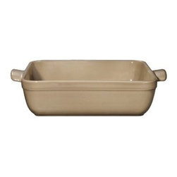 Emile Henry 2.1 qt. Square Baking Dish - Sand - With its versatile square shape and sturdy yet handsome handles, your Emile Henry 2.1 qt. Square Baking Dish - Sand easily goes from oven to table. It's made beautiful as well as durable and is perfect for au gratins, cakes, brownies, and more. It's handcrafted from mineral-rich clay found in Burgundy, France and fired in a high heat-resistant oven. The friendly sand color and translucent glaze are designed not to crack, discolor, or scratch. A perfect match to modern lifestyles, this baking dish can go straight from the freezer to a 500-degree oven. It's also designed for use in the microwave, broiler, and dishwasher. About Emile Henry Emile Henry was founded in 1850 and is located in Marcigny, a small town tucked within the province of Burgundy, France. It is still owned and operated by the Henry family. Over the generations Emile Henry has established a world-renowned reputation for creating the finest quality ceramic ovenware, gourmet cooking products, and exceptional bakeware products. Their products include baking dishes and cake stands. The discerning gourmand will recognize the quality in every loaf pan, casserole dish, stew pot, handcrafted pie dish, trivet, tagine, and brazier they create. Emile Henry manufacturers all of their cooking products from clay found in the Burgundy region. Burgundy is noted for their world-famous wines due in part to the mineral-rich limestone soil. It is this soil and clay that go into the special clay cookware crafting formulas that are the basis of all Emile Henry ceramic cookware products.