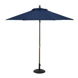 Round Market Umbrella with Eucalyptus Pole, 9', Solid, Ink Blue - Vibrant, sun-drenched colors make these umbrellas summer favorites. Choose from our three types of poles to help you complement outdoor furnishings. 6' diameter, 7.4' high 9' diameter, 8.25' high Choose eucalyptus, teak or aluminum pole. Wood pole is crafted from eucalyptus or premium teak, and features an easy-to-use pulley system, and three positions for the galvanized-metal locking pin that keeps the umbrella open. Sturdy aluminum pole in bronze finish has an easy-turn crank handle and tilt function. Designed to fit any Pottery Barn outdoor dining table that accommodates an umbrella. Please check umbrella pole diameter if using with other tables. Concrete stand (sold separately) can be used with any of our umbrellas for added stability. Simple assembly. Imported. Natural and Ink Blue are Catalog / Internet only. View our {{link path='pages/popups/fb-outdoor.html' class='popup' width='480' height='300'}}Furniture Brochure{{/link}}.