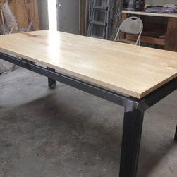 Floating Maple Top Dining Table - Available for sale. Floating top maple dining table (6' x 3') with a custom welded steel frame. Completed with adjustable feet.