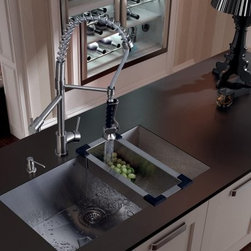 VIGO VG15067 Single Basin Undermount Kitchen Sink Set - Transform your kitchen with the VIGO VG15067 Single Basin Undermount Kitchen Sink Set having you covered from prep to cleanup with its colander, strainer, and soap dispenser. This set is made rust and scratch-resistant from stainless steel with a satin finish. The two-part faucet has an aerated-flow and a spraying head to get the job done. Both water pressure and temperature are adjusted with just a single lever. It comes ready to install with everything you need in the box.About Vigo Industries LLCFounded just over a decade ago in Rahway, N.J., Vigo Industries has established a reputation for offering attractive, affordable, innovative, and durable kitchen and bath products. From faucets and sinks to shower enclosures and bathroom vanities, Vigo's products are designed with state-of-the-art engineering that combines efficiency and elegance. Vigo's engineering and design teams always look ahead to fulfill the ever-evolving needs and tastes of consumers, bringing them the latest styles and trends without compromising quality.Manufacturer's WarrantyThis item includes a limited lifetime warranty.
