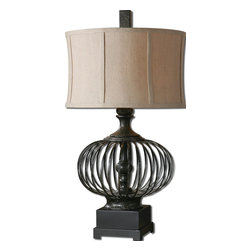 Uttermost - Lipioni Rustic Black Lamp - Rustic and exotic, this black table lamp offers something completely different to your traditional decor — a note of excitement. The black metal cage holds an interesting sculpture in the center. The round shade completes the architectural look topped by a black metal finial.