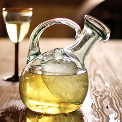 White Wine Decanter - Who said decanters were just for reds? Keep your white wine cool with this elegant decanter, handmade in Colombia from recycled glass. It looks great on the table for summer dinner parties, and it features a separate pocket for ice.
