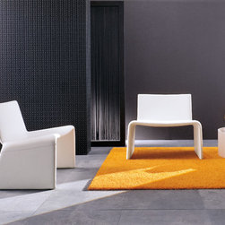 Porada Wood Furnishings - The Olivia armchair by Porada is an ultra stylish chair with a modern form and shapely back and legs. Head-to-toe upholstery in fabric, leather, or eco-pelle gives Olivia a sophisticated and elegant air.