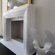 Contemporary Indoor Fireplaces by The Granite Shop