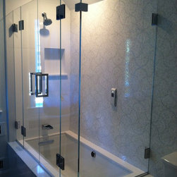 "Frameless Shower Doors, Frameless Glass Enclosures - Frameless enclosure for tub.  Double door system.  fully frameless.  Recently voted, ""fan-favorite"" on our facebook page.  Glass is 3/8"" PPG starphire low iron glass."