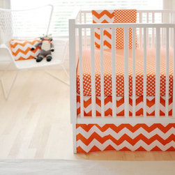 New Arrivals - New Arrivals Zig Zag Baby Crib Bedding Set - Tangerine Multicolor - CRIB2-ZZB TA - Shop for Bedding Sets from Hayneedle.com! Add a fresh bright look to your little one s nursery with the New Arrivals Zig Zag Baby Crib Bedding Set Tangerine. Made of soft 100% cotton this two-piece bedding set includes a crib skirt and cozy crib sheet. Each piece can be cleaned by machine washing in cold water. Complete this crib bedding collection by adding the matching blanket and bumper (both optional). The bumper is dry clean only. The crib skirt features a white and orange chevron design while the crib sheet displays a fun orange and white array of polka dots.About New Arrivals Inc.New Arrivals Inc. was started 15 years ago by mom-of-three Tori Swaim. What started as a small accessory and gift product line has grown into hundreds of products including bedding nursery and kids room decor letters and baby gifts. New Arrivals Inc. is your one-stop-shop for designing the baby nursery or kids room of your dreams.