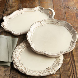 """Horchow - Oval Charger Plate - Add texture to the table. Antiqued white wooden charger plates provide the perfect accent in three shapes. Handcrafted and hand painted in Italy. Oval charger plate, 13""""W x 18""""L. Scalloped charger plate, 13.75""""Dia. Baroque charger plate, 13.75""""Dia...."""