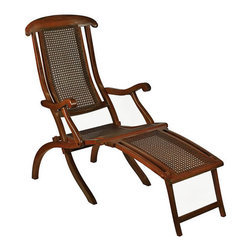 """French Line Deck Chair - The French line deck chair measures 55.25"""" x 41.5"""" x 22"""". This is a deck Chair that would have been found on the sun deck of your ship as she sailed for exotic locations all over the world, circa mid to late 19th and early 20th Century. Relive those nostalgic days on your favorite sun deck. Ocean Liners had a brief but glorious Golden Age when steam replaced sail. The early 1900s saw huge steam vessels crossing the Atlantic, taking immigrants to the New World in steerage, while pampering royalty and the wealthy set in staterooms. After dancing the night away in ornate ballrooms they collapsed in rows of deck chairs with cushions and blankets to admire the sunrise. Hot chocolate, coffee, tea, and croissants were served for breakfast... then off to bed! The chair is made from plantation grown hardwood and wicker. It has leg support that adjusts up or down. It folds down for storage in rough seas. It's distressed French finish color is brown."""