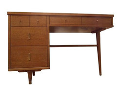 Pre-owned Vintage Mid-Century Writing Desk - Beautiful mid-century oak writing desk with brass capped feet. All original hardware and in prime condition. Has one long drawer up top and three smaller ones on the left. Bought from original owner who obviously took very good care of it. Would make a beautiful addition to a home office space.