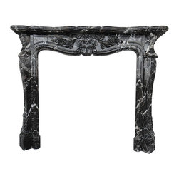 Marble Fireplaces Mantels - Black marble fireplace in the French style. Great for a large master bedroom. White veining throughout the fireplace mantel. Beautiful design and a great idea for a any style home.