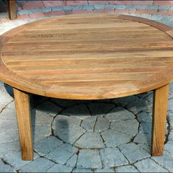 Fifthroom - Teak Round Coffee Table - This round coffee table features slatted center detailing and tapered legs for a stylish and durable coffee table.  The high quality teak wood makes it suitable for both outdoor living areas and indoor use.  The 40 inch diameter allows plenty of room for games, coffee, and snacks.  Nestle it within a teak furniture set for suburb entertaining.