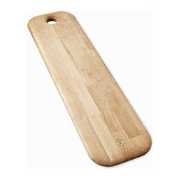 Tom Dixon - Tom Dixon | Chop Long - Designed by Tom Dixon, 2012.Tom Dixon's Chop Long chopping board is milled from solid European oak. Adorned with a gently curved edge and solid brass Tom Dixon logo, each chopping board is attractive enough to be used for both chopping and serving. A hole at the top can be used as a hanger or a handle.This accessory is from the ECLECTIC Collection- Tom Dixon's first collection to focus on everyday home accessories, giftware and design objects. Launched in January 2012 at Maison & Objet, the collection uses honest and resilient materials traditional to Tom Dixon, including copper, brass, marble, cast iron and wood. The products are informed by British heritage and each piece is designed to be used, played with, treasured or given.All ECLECTIC pieces make excellent gifts and arrive in packaging that is meant to inspire curiosity and anticipation.