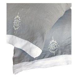 His/Her Pillowcases, Standard - A tongue-in-cheek newlywed favorite gets an upscale re-envisioning in these elegantly-embroidered standard-sized His and Hers Pillow Cases. Made from pure linen in a sophisticated deep dove grey, the pillow cases have neat contrast cuffs with stitched hems in a white cloth that matches the understated embroidery motifs - which are simply the words his and hers stitched in curving capitals at the center of tasteful wreaths.