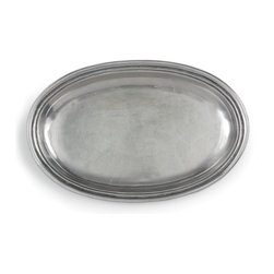 Peltro Small Oval Dish - Be prepared for every eventuality of serving and d�cor with a Peltro Small Oval Dish � suitable as an unusual bread plate or appetizer plate, it also looks wonderful as a soap dish in a transitional or old-world bath, and its traditional pewter construction lends that iconic sheen to cocktail-table vignettes.  Lovely to display or useful with your dishware, this piece of authentically handcrafted Italian pewter lends its weighty simplicity anywhere you use it.