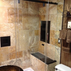 "Frameless Shower Doors, Frameless Glass Enclosures - Hydroslide shower enclosure, configured as a panel, door, panel.  All hardware is oil rubbed bronze.  Glass is 3/8"" PPG starphire low iron."