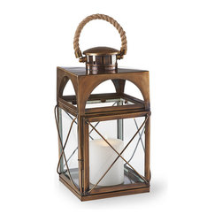 "Frontgate - Nautical Outdoor Lantern - Ideal accent lighting for a side table or on the ground next to a furniture collection. Holds a 4"" dia. candle (sold separately). Can also be used with a battery-operated candle (sold separately). Features an easy-latch door so you can place candle inside and clean. Venting in top allows heat to escape. Channel the spirit of the seas with our exclusive Nautical Lantern, boasting a classic ship lantern design. The stainless steel cage and clear glass make a stately showcase for candlelight in any outdoor space, while the rope handle atop a brass cone adds coastal styling. . . . . . Drain hole whisks away rain water. Attached rope handle; arrives assembled. Can be used indoors or outdoors; recommended to bring inside during inclement weather. Wipe clean with a soft, damp cloth."