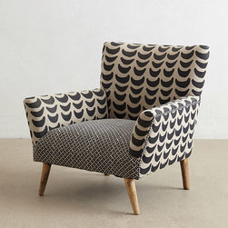 Bangala Armchair - Kick back in this seat's angular silhouette, which is designed to complement contemporary living spaces. Handcrafted from sturdy mango wood and upholstered in fine linen, it combines the clean lines of Danish design with the modern appeal of midcentury style.