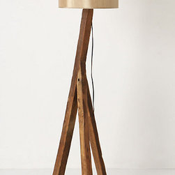 Tripod Floor Lamp - The soft, silk shade lightens up this beautiful reclaimed wood tripod lamp. What a great feature in a room! I'd tuck it in a corner right over a big tufted chair to create the perfect reading nook.