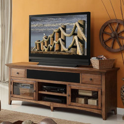 Legends - Legends Vineyard 76 in. Media Console - Reclaimed - ZR-V1476 - Shop for Visual Centers and Stands from Hayneedle.com! With its spacious top and bold transitional style the Legends Vineyard 76 in. Media Console - Reclaimed is a natural choice for your home theater. It's crafted of solid wood with a reclaimed finish and antiqued iron hardware and offers ample storage in the form of two glass doors with shelving behind each two small drawers to keep things organized two central cubbies and a wide open space that accommodates components or the latest sound bar technology (optional speaker grill included). Rear cord management is there to keep cables and wires tidy. About Legends FurnitureLegends Furniture got their humble start in 1990 from an 800-sq-ft. workspace and has since grown to a state-of-the-art facility on more than 26 acres. Through all their changes quality and customer service has always been their main objective. Legends attributes their growth and success to their customer first policy and their product that's a good solid value any way you look at it. Legends manufactures a full line of home entertainment home office and bedroom furniture here in the U.S.A. They also import select items from Southern China and Malaysia to bring you a wide range of styles and prices. They want to be a world class vendor who gives you their customer the best of both worlds.