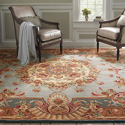 Frontgate - Lourdet Hand-Tufted Area Rug - Hand-tufted. Decorative frieze carvings. Durable, 100% cotton backing. With its classic floral medallion and elaborate leafy border, our Lourdet Hand-Tufted Area Rug is an elegant adaptation of the prestigious French Savonnerie style. Beautifully crafted with impeccable attention to detail, this densely woven wool rug adds warmth and Old World sophistication to any room, even high-traffic areas.  .  .  . Imported. Rug designs will vary by size.
