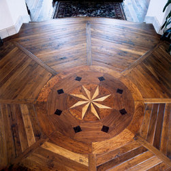 Hand Scraped French Country Cherry with Inlay in foyer - This fumed French Country Cherry has been hand scraped and inlaid into a fan pattern with a star inlay in this foyer.