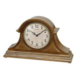 Rhythm Clocks - Joyful Remington Musical Clock Oak CRH204UR06 - Dressed in a beautiful oak case with corner overlays, the Joyful Remington is a classic tambour style clock. The clocks face is done in a rustic look with Arabic numerals. Plays one of 28 melodies on the hour...6 Hymns, 6 Christmas, or 16 Classical / Folk melodies. Quartz clock is battery operated.