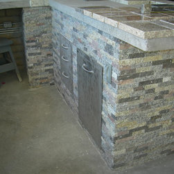 Outdoor Accents - Still under construction this huge outdoor kitchen is clad in our Superstition Ridge Blend and will feature a mosaic countertop constructed from our Granite Pavers.