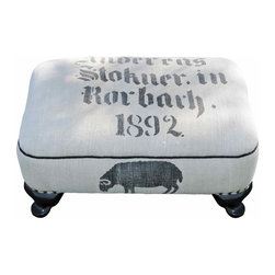 German  Grain Sack Ottoman - This solid wood footstool dates around 1950. It features a hand-loomed German grain sack with a lovely grazing ram.