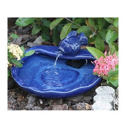 Smart Solar Products - Smart Solar Products - Solar Koi Fountain - Solar powered blue glazed ceramic koi water feature. Water flows constantly through the koi\'s mouth and into the bowl. Constantly recycles the same water.  Operates in direct sunlight. Powered by a separate solar panel (supplied). Multi fixing panel holder. Low voltage water pump with filter