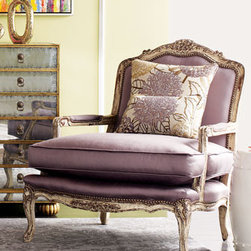 """Olivia"" Chair - As beautiful as its name, the ""Olivia"" chair is upholstered in a soft shade of lavender.  The pillows that come with this chair are dressed in a leafy floral pattern for added interest.  This chair would be equally at home in a living room or bedroom.32""W x 38.5""D x 38""T. USA made."