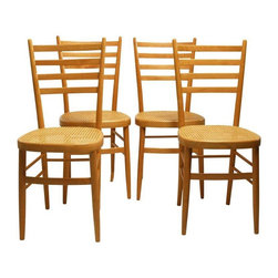 "Set of 4 Ladderback Dining Chairs with Cane Seats - Great set of 4 vintage ladderback dining chairs with caned seats, circa 1950s. The chairs are in very good original condition showing very light age appropriate finish wear. The caned seats are in excellent condition. Origin unknown, possibly Italian. Seat height 19""."